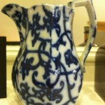 White china jug with pattern of blue vines and leaves.
